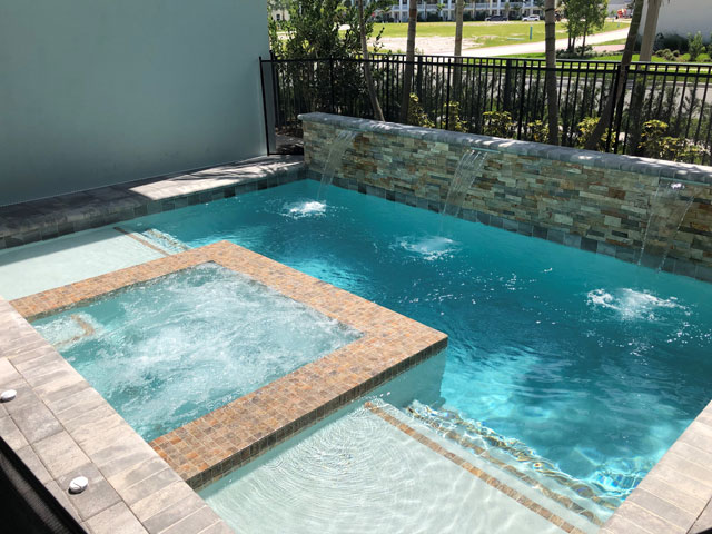 Traditional Pool with Spa and Fountains